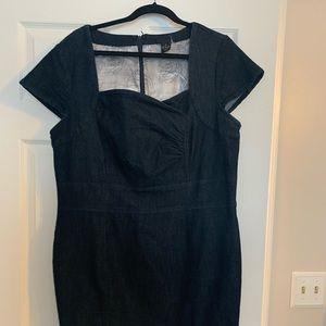 Super cute jean dress.